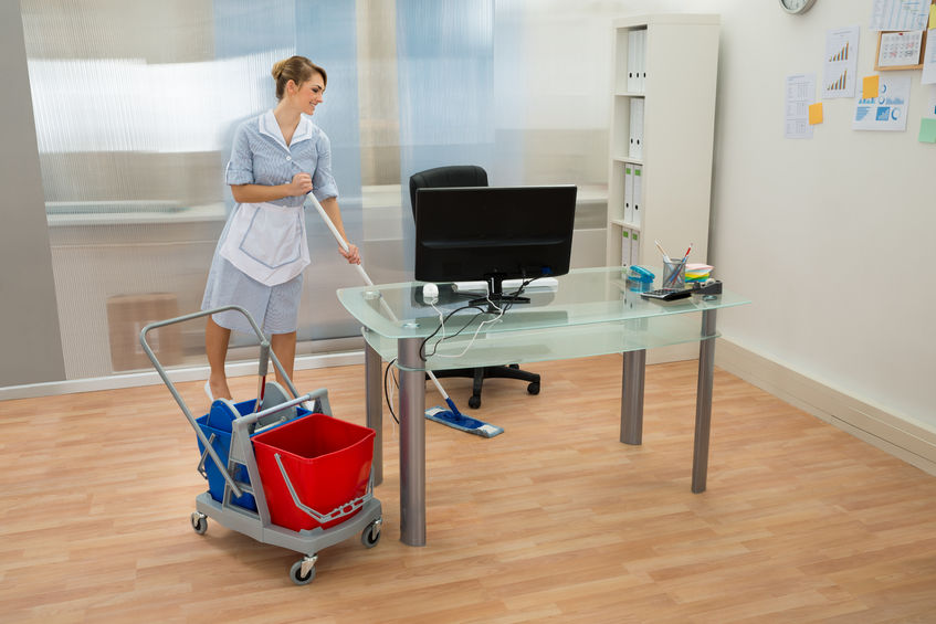 39899715 - young happy female maid cleaning floor in office